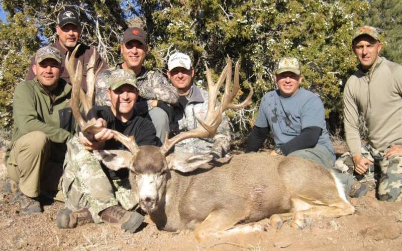 The Ridge Reaper crew all join in to pose with a giant Utah buck! (Courtesy Ridge Reaper)