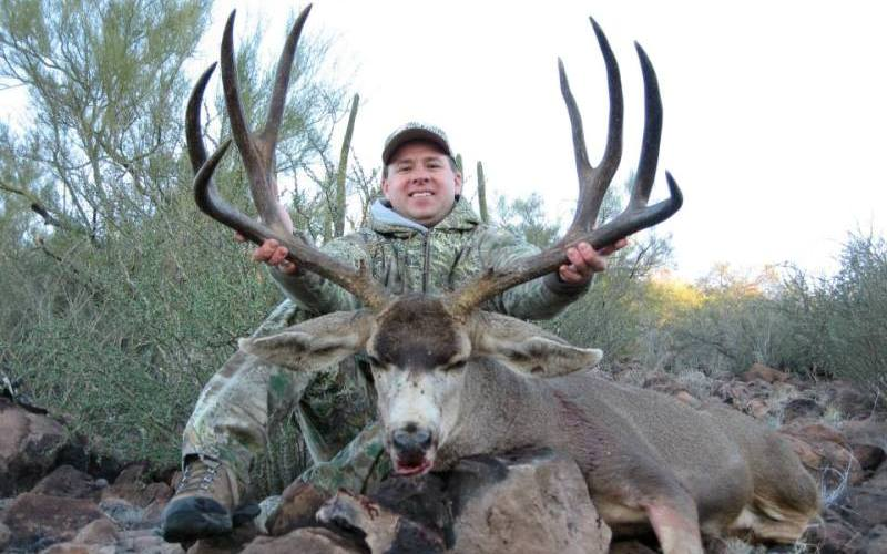 Carter shows off a typical muley in Mexico. (Courtesy Ridge Reaper)