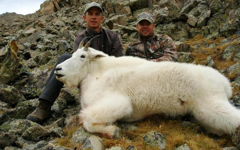 Roger Smithson and Carter in Colorado with a mountain goat. (Courtesy Ridge Reaper)